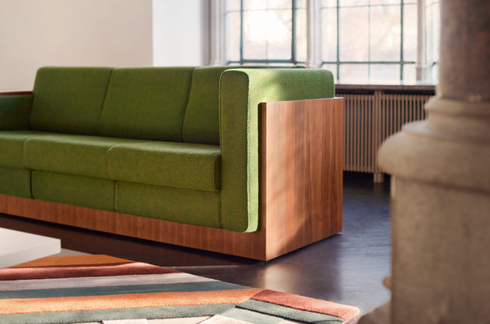 "Wood and fabric: The ""Alpha Seating Sofa"" combines a solid body with soft woolen fabrics from Kvadrat."