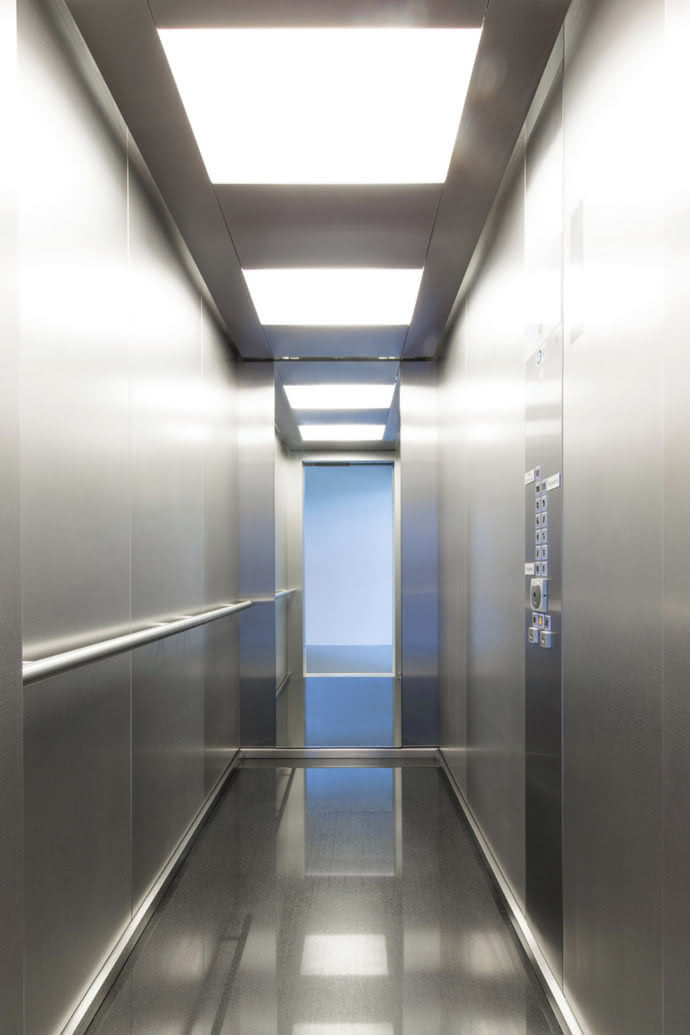 Aesthetic view: The interior of the elevator, which is held in stainless steel, is set in scene with a futuristic ceiling design and LED lighting.