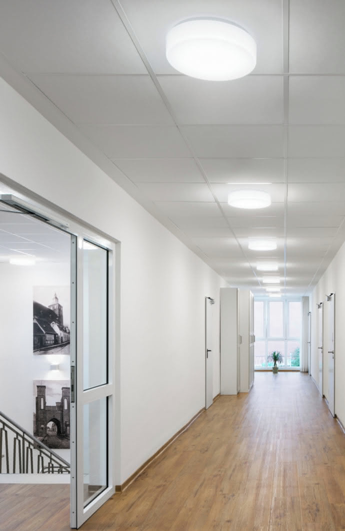"The ceiling luminaire ""Oblo"" was installed to provide ideal lighting in the corridors."