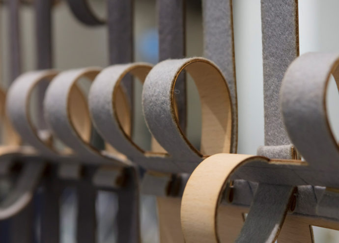"Flexible loops: Bára Finnsdottir created the sound-absorbing partition ""Merging Loops"" using felt and veneer."