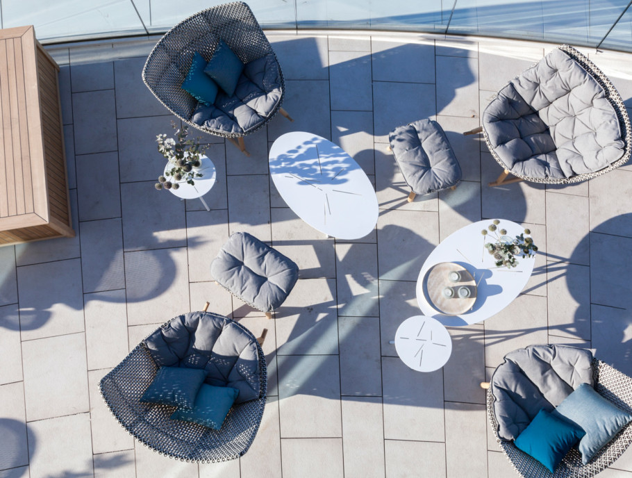 "Roof terrace with ""Mangrove"" side tables and ""Mbrace"" chairs and ""Mbrace"" stools by Dedon"