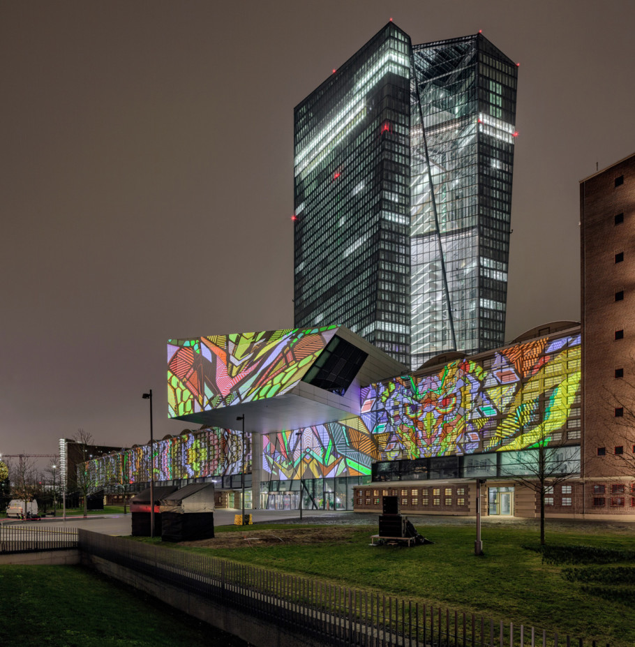 """""""Cross Hatch"""" by Urbanscreen transforms a part of the façade of the European Central Bank into an animated street art gallery."""