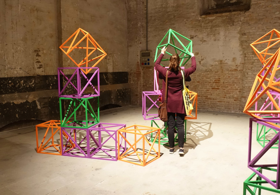 "Participation wanted: The central exhibition entitled ""Viva Arte Viva"" curated by the Biennale's Artistic Director Christine Macel consists of nine chapters in total. It starts in the Arsenale with the ""Pavilion of the Common"". There, among others, Rasheed Araeen presents his piece ""Zero to Infinity"" first conceived in 1968 as a ""Biostructural Play"": the audience can arrange colored cubes at will."