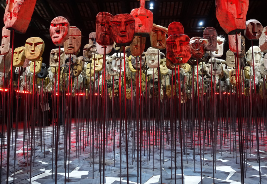Preventing the public extinction of history: In the Chilean Pavilion, Bernardo Oyarzún presents 1,500 masks surrounded by a luminescent strip with 6,906 Mapuche names.