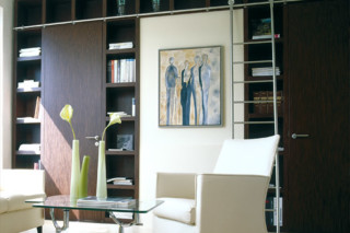 Bookcase with integrated doors  by  Bartels
