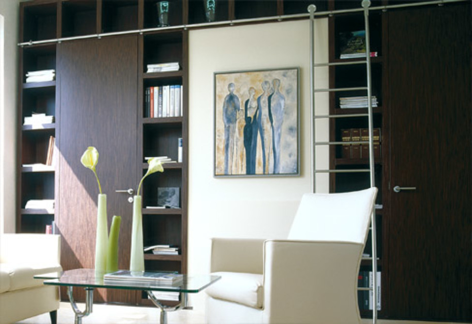 Bookcase with integrated doors