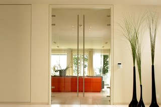 Ceiling high full glass door  by  Bartels