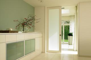 Ceiling high sliding door  by  Bartels