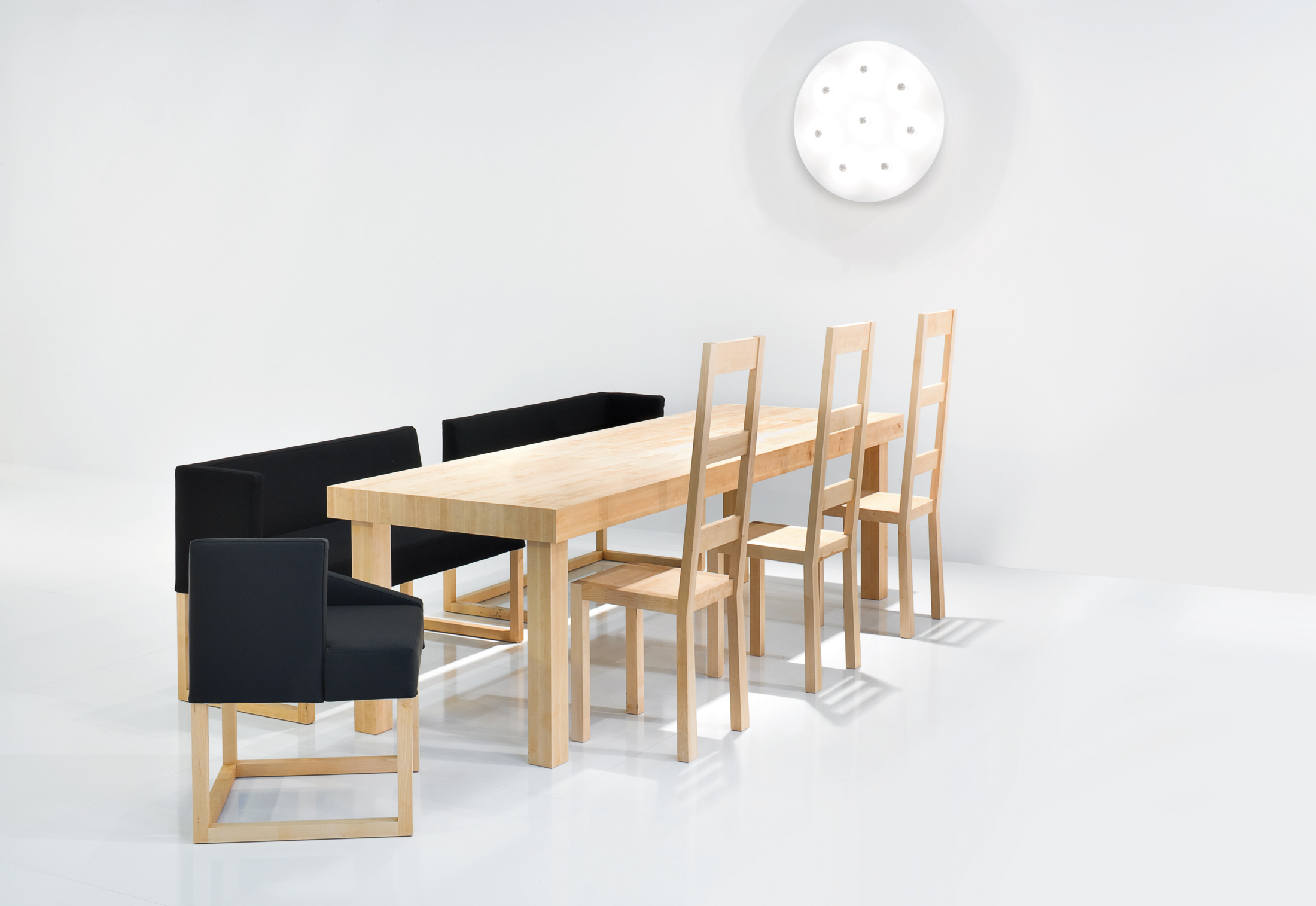 Two Dining Benches Next To Each Other