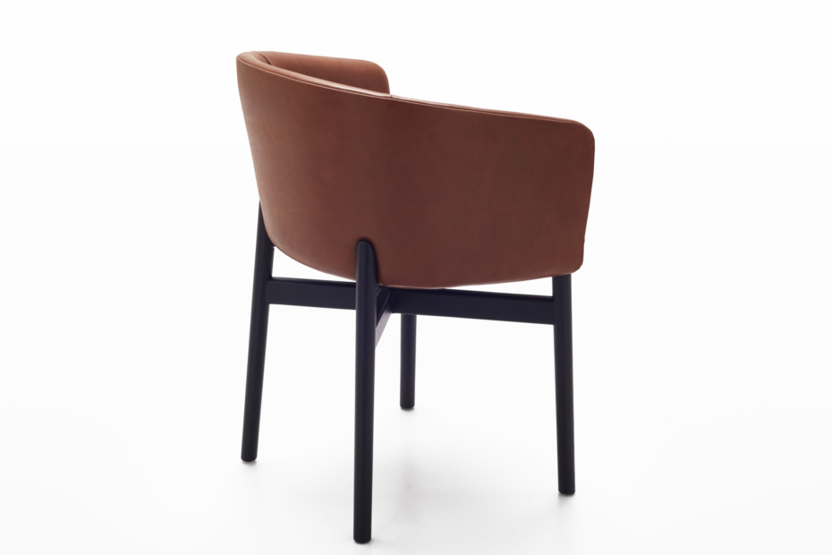 Krusin armchair with an enveloping back