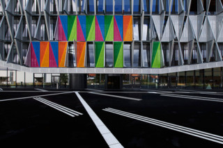 Perforated  triangular screens as cladding, University Campus in Kolding  by  RMIG