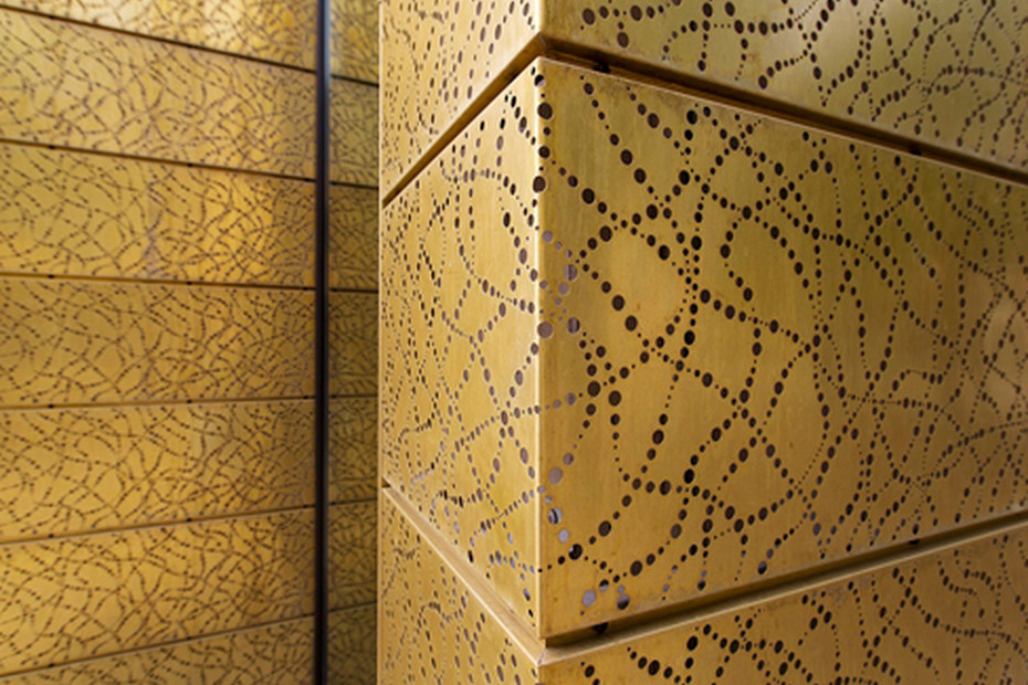 Special designed perforation in TECU® Gold panels as facade, Bang & Olufsen Store in Herning
