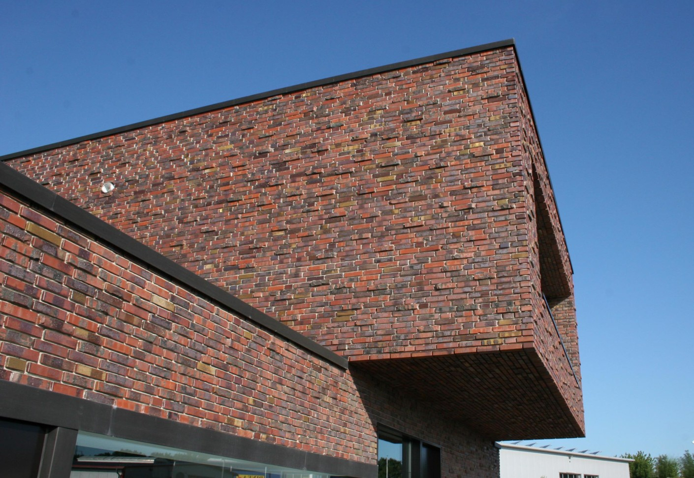 Facade bricks office building neuenkirchen by for Brick facade house