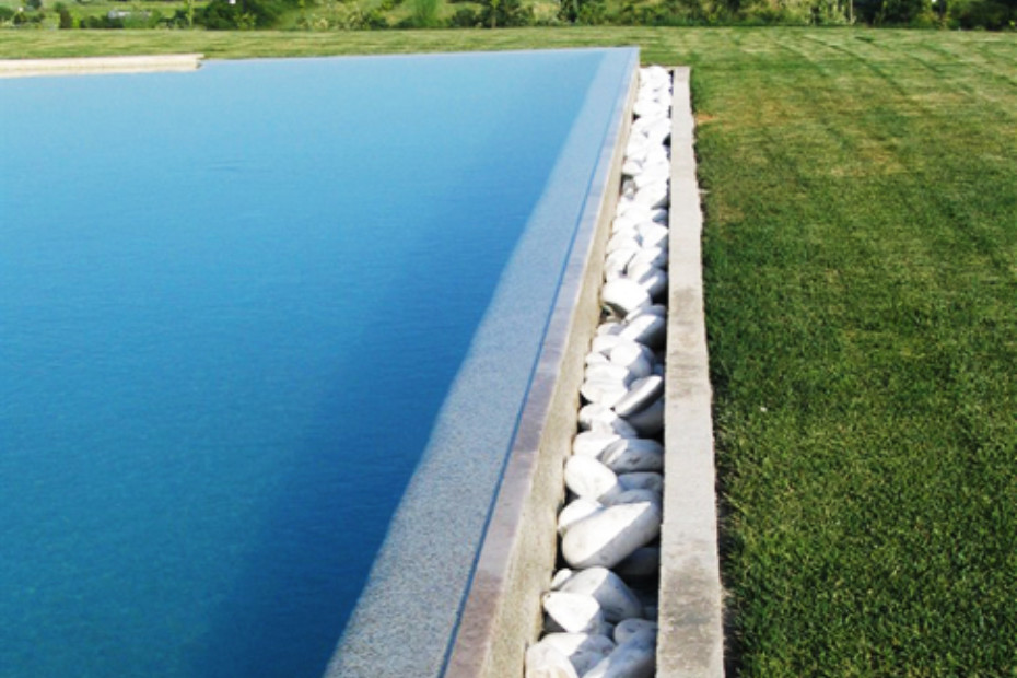 Beach Overflow Swimming Pool Coated In Stone By Indalo