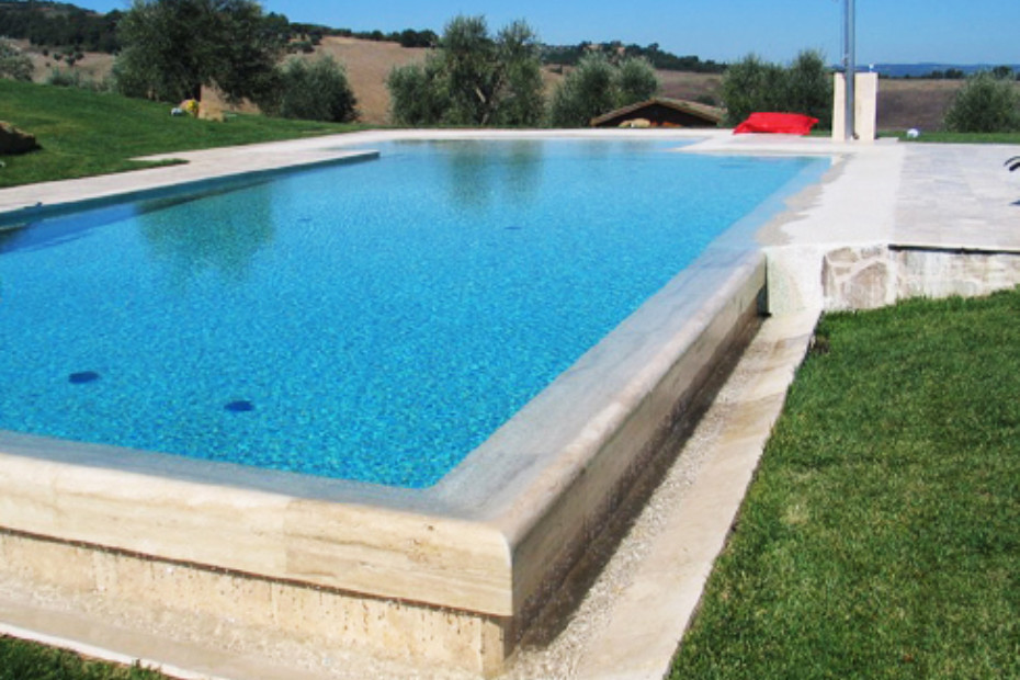 Beach overflow swimming pool covered with natural stone by ...