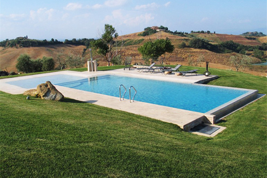 Beach overflow swimming pool covered with natural stone