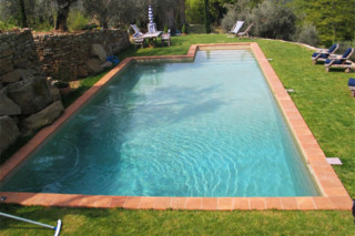 Swimming pool skimmer coated with natural stone  by  Indalo Piscine