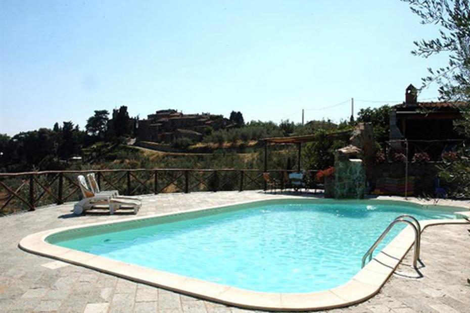 Swimming pool with rock waterfall