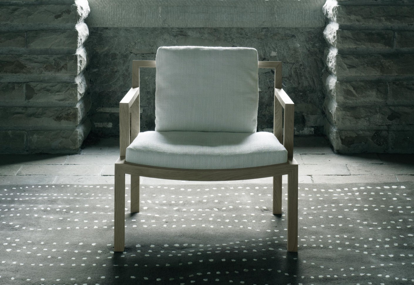Gray lounge chair by Living Divani