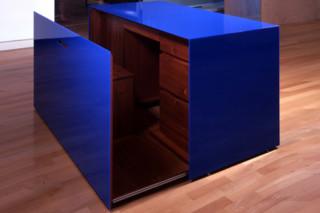 Blue acrylic desk  by  Paul Kelley