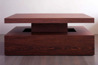 Rosewood table and benches  by  Paul Kelley