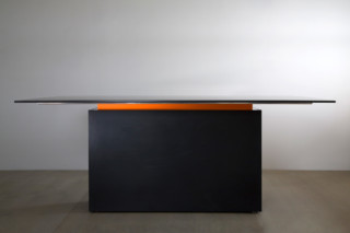 Solid surface table  by  Paul Kelley