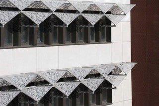 Perforated sun screens,  Lycée Polyvalent in Saint Romain  by  RMIG