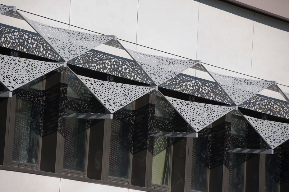 Perforated sun screens,  Lycée Polyvalent in Saint Romain