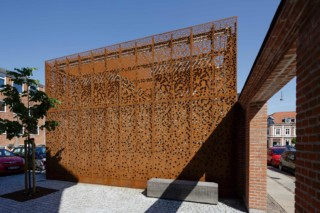Perforated Corten panels as cladding, Municipal building in Danmarksgade - Aalborg  by  RMIG