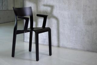 Torsio chair wirh armrests  by  Röthlisberger