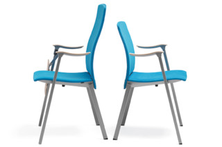 Flok chair with armrest upholstered  by  Materia
