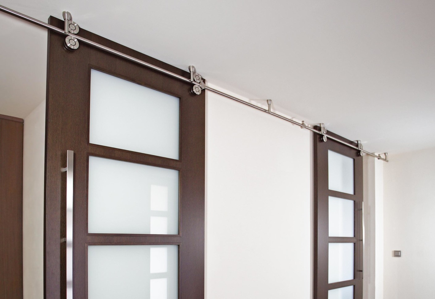 Twin sliding door system by mwe stylepark for Sliding door manufacturers